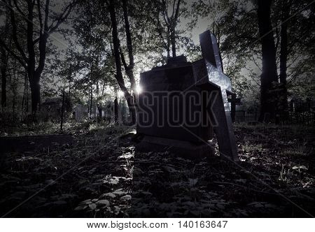 Headstone in the old cemetery. Halloween concept