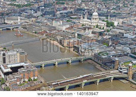 Aerial view of the City of London with St Paul's Cathedral dominating the skyline.