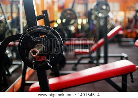 Barbell ready for workout, indoors, selective focus