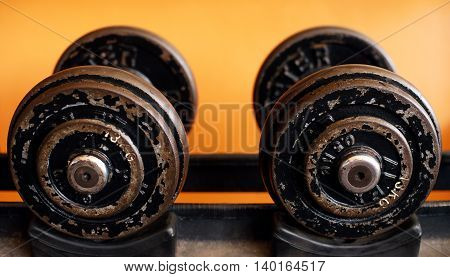 Two old but well used set of dumbbells at the gym.