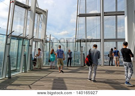 LONDON UNITED KINGDOM - JULY 2 2014: Visitors enjoying the great view from the open-air public viewing platform of the Shard Building.