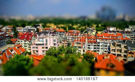 Tilt-shift panoramic effect photo of cityscape with residential buildings