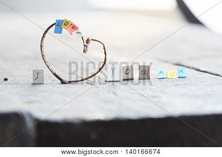 text I Love You Mom for Happy Mothers Day celebration, heart with colorful letters