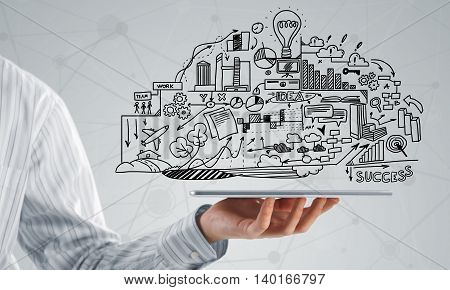 Businessman hand demostrating business strategy plan on tablet screen