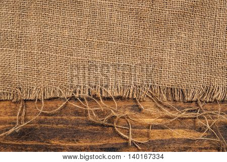 Burlap hessian sacking on wooden background rustic backdrop