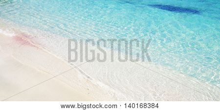 white sand and blue water on the beach