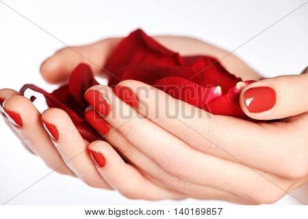 Beautiful Female Finger Nails With Red Nail Closeup On Petals. P