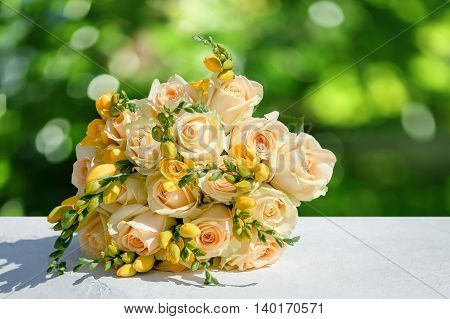 beautiful wedding bouquet of the bride. yellow roses