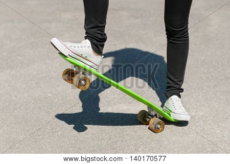 Skateboarder performing a trick on a skateboard.