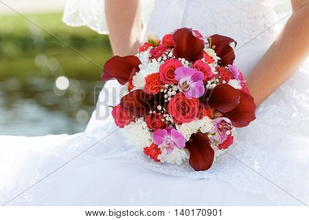 bride's bouquet of red Calla lilies roses carnations and orchids