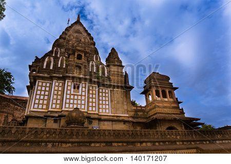 Ahilya temple in Maheshwar, Madhya pradesh set againt the impressive monsoon clouds. This famous landmark is a popular tourist destination