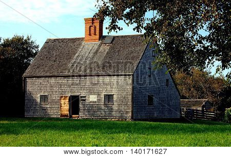 Nantucket Island Massachusetts - October 12 2008: 1686 wooden singled saltbox Jethro Coffin House with casement windows and central chimney