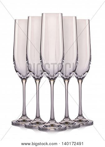 Set of empty champagne glasses isolated on a white background.