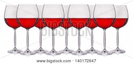 Set of red wine in a glass isolated on white background.