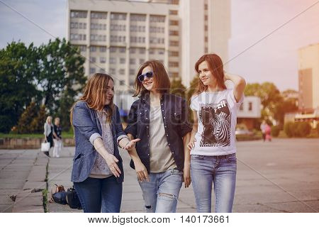 three beautiful girls walking in the park