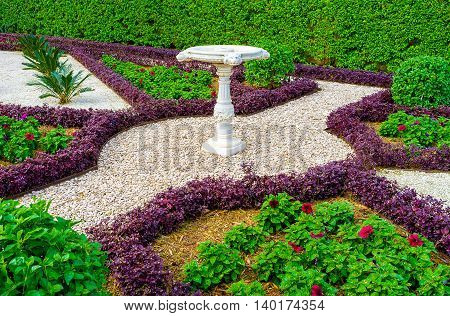 The footpaths in Bahai gardens fenced with different plant borders and covered with gravel make nice ornaments on earth Haifa Israel.