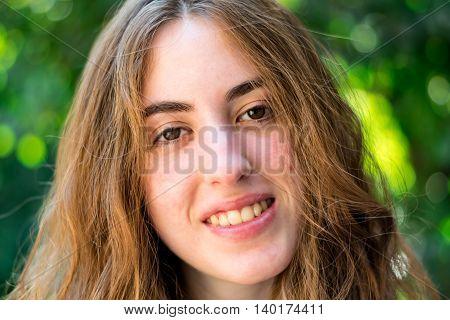 Long haired teenage girl facing the camera