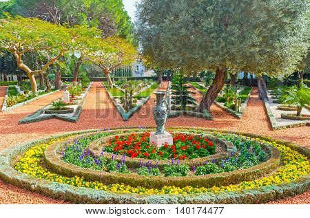 The gravel paths diverge like the rays of a star separated with the colorful flower beds Bahai Gardens Haifa Israel.