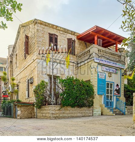 HAIFA ISRAEL - FEBRUARY 20 2016: The facade of Seven Laws for Seventy Nations Center located in old building in German Colony and works to promote the application of the Seven Universal Laws on February 20 in Haifa.
