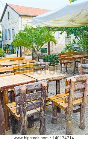 The rustic restaurant with the timbered furniture in the summer terrace Haifa Israel.