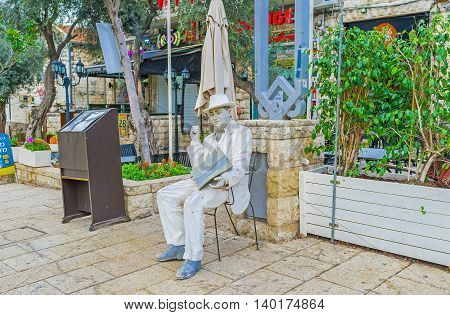 HAIFA ISRAEL - FEBRUARY 20 2016: The white mannequin with a menu advertises the restaurant of local cuisine located in German Colony on February 20 in Haifa.