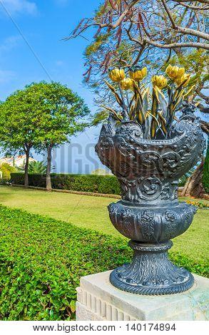 The bouquet of golden tulips in vase decorates the Bahai Garden Haifa Israel.