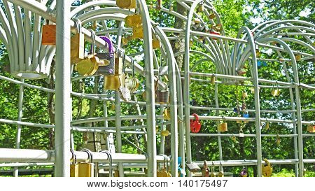 A lot of wedding locks on high metal construction