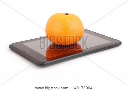An orange fruit on the tablet PC. Closeup with clipping path