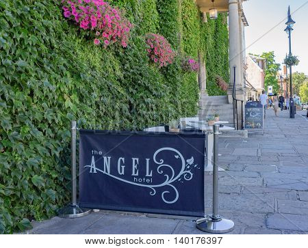 Bury St Edmunds/UK. 18th July 2016. The Angel Hotel has a small cafe terrace overlooking the Abbey Gardens to the front.