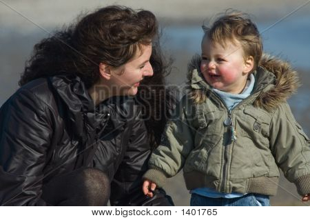 Mother And Cute Boy On The Beach