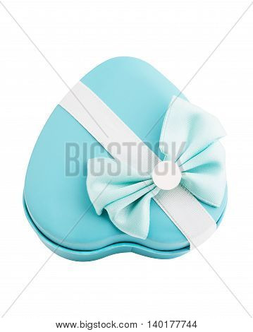 Metallic gift box shape heart with a bow isolated. Top view