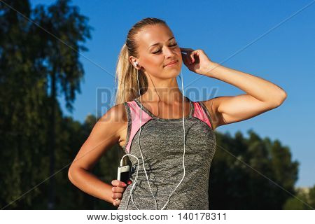 Young Attractive Woman Listening To Music
