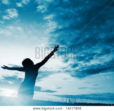 Young woman over blue abstract clouds background