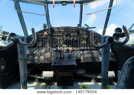 Vintage airplane dashboard, shallow focus on leverers