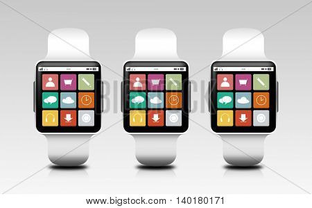 modern technology, object, responsive design and media concept - smart watches with menu icons on screen over gray background