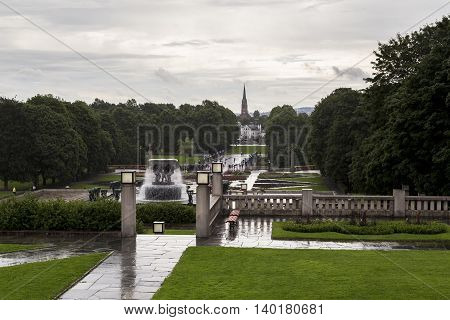 OSLO, NORWAY - JULY 1, 2016: This is sculpture park Vigeland early rainy summer morning.