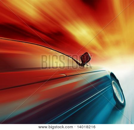 Blurry sport car with red sky and clouds