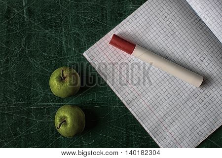 Apple And Marker On Blackboard