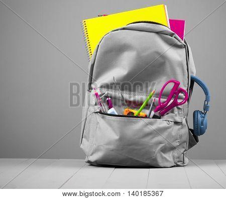 School backpack on grey background