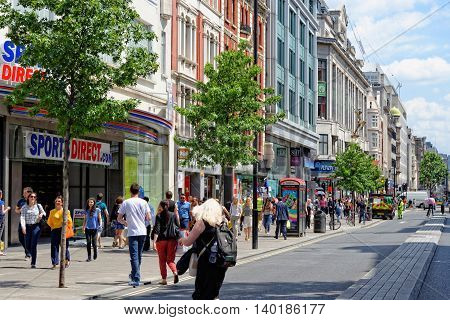 LONDON - JULY 1 2014. Shoppers on Oxford street the biggest shopping street in Europe visited by millions of tourists.