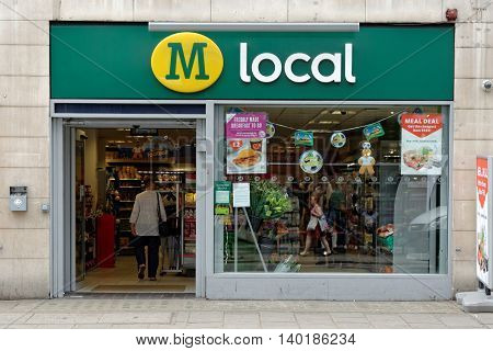 LONDON UK - JULY 1 2014: The exterior of a Morrison local supermarket on a street in central London. Morrison is the fourth largest chain of supermarkets in the UK with headquarters in Bradford.