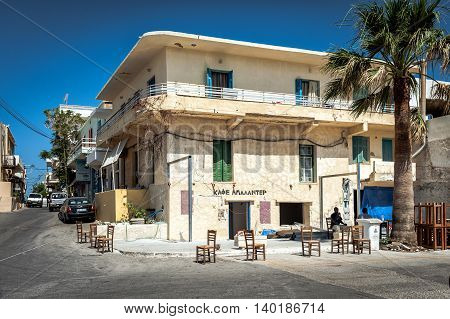 PALEOCHORA, CRETE, GREECE - JUNE 2016: Traditional Greek tavern, located in typical Greek house in Paleochora town on Crete island