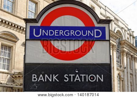LONDON UK - JULY 1 2014: Underground station sign Bank in the City of London one of the leading centres of global finance.