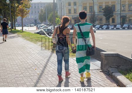 Kiev Ukraine - September 19 2015: Two girls-lesbians are on the street next to St. Michael's Cathedral