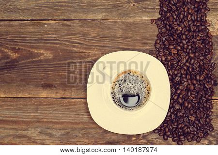 coffee beans and cup on wood table
