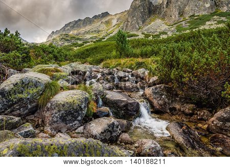 Mountain Landscape with a Creek and Rocks in Foreground on Cloudy Day. Mlynicka Valley High Tatra Slovakia.