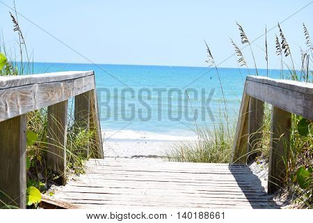 View of the Bright Blue Ocean from Sandy Beach Boardwalk