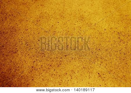 Selective focus gold textured background. Horizontal 3:2 format.