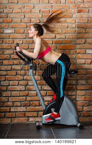 Active Woman Doing Sport Biking.