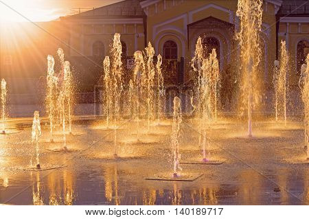 A fountain at Poshtova square under the bright sunbeams Kiev Ukraine